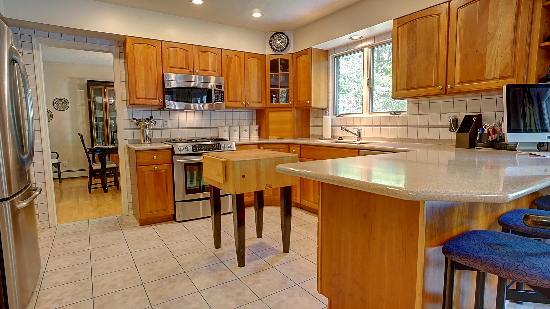 Cherry cabinets, Corian Counter tops, Tile back splash