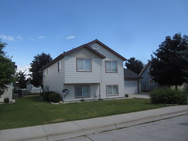 This large home has four bedrooms and 2 baths, laundry room, office, and gas fireplace.