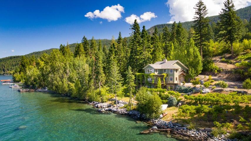 200 feet of Flathead Lake frontage + privacy, vineyard, year round creek, gorgeous home!