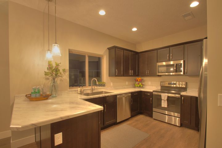 Slate Finish Package with Transitional Lighting and Stainless Appliances