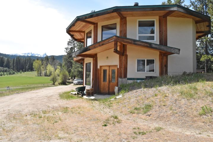 House sits at the top of the lot. Notice Trapper Peak behind