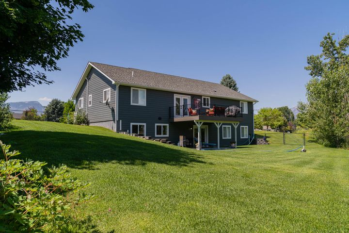 The walkout basement provides quick access to the lush lawn, irrigated with ditch rights.