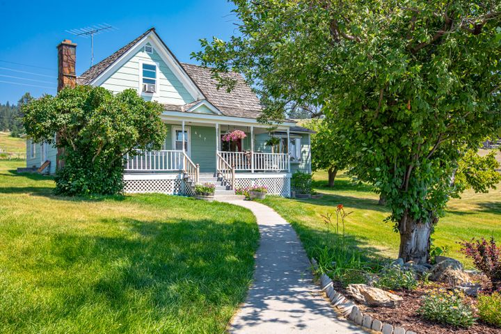 Cute farmhouse just west of town on 5 acres
