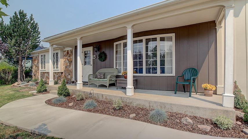 Spacious front porch with beautiful bow window.