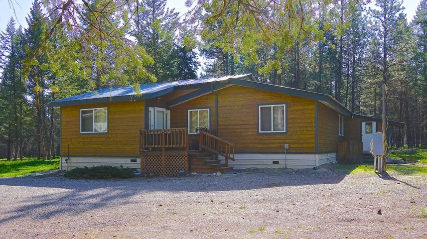 Price reduced !!! Enjoy NW Montana living on this  beautiful wooded property nestled up against National Forest Land with walking access to Lake Koocanusa ! This 2 bed/2bath home has just had brand new siding installed and the interior repainted and has a large living room and an additional room that with a few minor modifications could be made into a 3rd bedroom. The property is located in the beautiful West Kootenai area where recreation abounds! The property also boasts a roomy finished garage equipped with a wood stove.  A boat shed to store the boat in during the winter. Call today for an appointment to see this property!