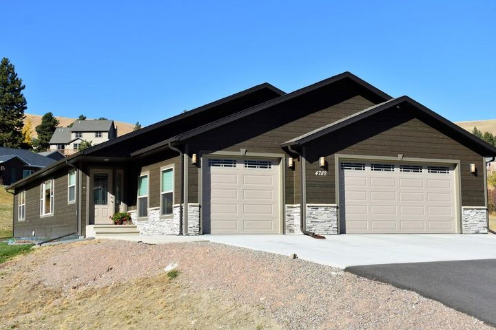 Single level living on desirable 2 acre lot with superior views next to Broadwater Hot Springs. 1914 sq ft, 3bedroom 2.5 bath home with top of the line kitchen!  This home boasts silestone counter tops, stainless appliances, alder cabinets, gas range, vaulted ceilings, abundant light, custom blinds and a large (3'x7') island for entertaining!  Large master suite has abundant storage, soaker tub, and attractive tile floors in bathroom with radiant heat. Outside you will enjoy a 3 car finished garage (even plumbed for gas heat), private patio, sweet view, lots of space for a future shop and even a second graveled driveway leading to the perfect location. Quality construction with extra insulation (leading to very affordable power bills)  and lots of detail throughout!