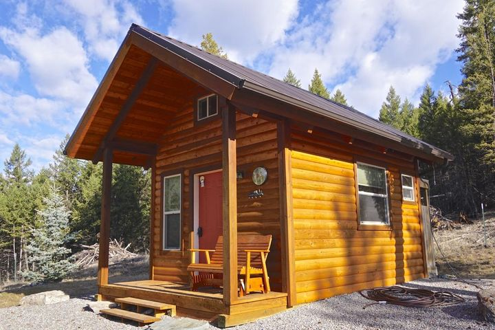 Nw Montana retreat, checkout the ''sugar shack'', a well built  mini-house that has a sleeping quarters and a half bath, bring your  rv, the  hookup is in place and host the reunions and the summer cookouts in the attractive and well built post and beam pavilion ! The well is drilled and the septic system is installed, you have  a garage built for storage, you are steps away from State lands (borders 2 sides) and the property corners to National Forest service lands as well ! You are just a short drive to beautiful Lake Koocanusa and best of all it is located in the quiet and desirable community known as the West Kootenai !!
