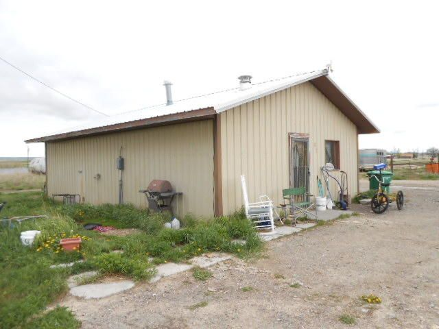 Little house and big shop. House is nice and cozy, although small. Shop needs a roof badly, but could be a dandy. End of private road. Don't go on the property without your Realtor. Seller to have easements through this property to access her additional adjoining properties.