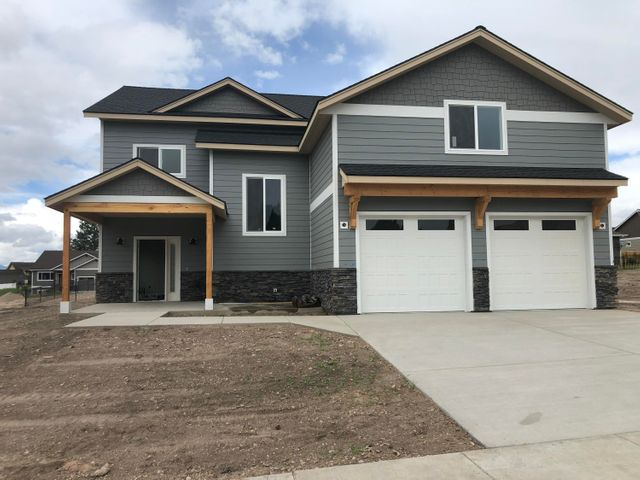 Nice large home with many high end upgrades. 4 Bedrooms 2.5 bathrooms. This is a must see home with a great open floor plan. Granite counter tops, stainless steel appliances, wood cabinets stone accents, gas fireplace and covered rear patio. Sited in a nice newer neighborhood surrounded by new homes.