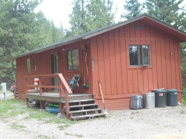 Bring your Ideas!   Good opportunity to own an affordable home between Missoula and Lolo on 5 acres.  Reddish cabin has approximately 640 sq ft and has 1-2 bedrooms, kitchen, bath and front porch.  The Green building  has approximately 564 sq ft and has 3 rooms,  porch and a storage area located on ground level.  The well is shared by this property and the neighbor.  For more information, call Jim Wheeler at (406) 239-1206 or your real estate professional.