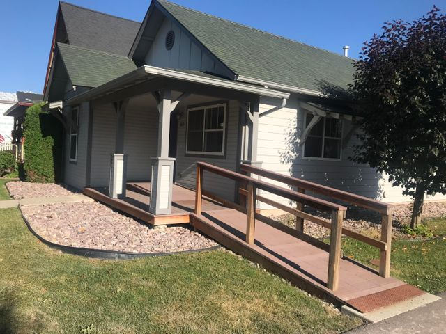 This house has a ton of upgrades. ADA ramps in the front and rear doors. ADA grab bars in the bathrooms. The oversized garage is heated with a Lennox Gas Heater and has an oversized 8' door. Large storage shed on the back of the garage. Very nice corner lot. On demand hot water heater. Underground sprinklers.