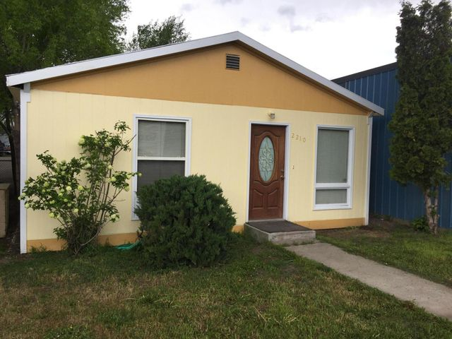 Central Location, close to shopping, large kitchen, free standing gas fire place,, updated bath, kitchen and electrical,  parking in the rear, ,new siding and paint, new roof 1 year ago,.    Urban renewal district,   Zoned commercial so great for a small business, 13,700  traffic count.