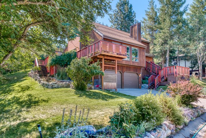 Tucked into one of the Rattlesnake most desirable neighborhoods, this home affords a great Missoula lifestyle: a small creek with bountiful wildlife habitat along one side, direct walking access to Mt. Jumbo trails on a quiet and well-loved street with big views and nature up close from every window. This home has been meticulously maintained and upgraded inside with attention to detail and design,  take note of the Cherry wood shelves, natural stone fireplace, modern quartz countertops,  cozy radiant heat, maple flooring, and light-filled rooms in a flowing split-level layout. Call Tim McGill 406-531-8868 Erin McCollum 406-529-7882 or your real estate professional.