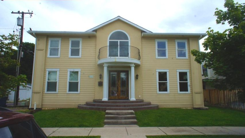 Built in 2007, this spacious majestic home is located in Missoula's coveted U-District.  Just one block to the University of Montana's campus and University Avenue.  The home greets you with a large and open entry way, high ceilings, bright windows and a beautiful fireplace.  Hardwood, granite, and tile finishes throughout.  This would be an ideal home to keep as a profitable rental or as your personal residence.  Almost 1700 sq. ft. per floor with bathrooms and bedrooms on each level give ample space to spread out and entertain. An attached two car garage and off-street parking to appreciate. Call Tom @ (406)370-2279 or your real estate professional for showings.