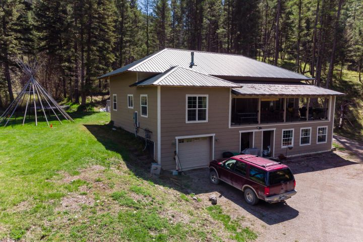 Perhaps you are looking for that very unique property, the one with everything planned out for outdoor adventure, interior comfort, a river on the property, and lots of sustainability. Look no further than 10780 Grant Creek Rd. There is so much opportunity at this location, the land is right next to hiking trails all over Grant Creek. Grant Creek frontage is running at the front edge of the property, and there are little steps down to the creek bank. The home is unique: it is constructed of insulated concrete. This construction method uses 12 inch insulated concrete as opposed to wood framing, making for a far more durable house and improved insulation against elements. The deck upstairs looks out over the property, andone can hear Grant Creek from the deck. The roof is a metal roof.