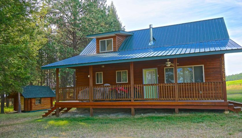 Are you ready  to enjoy NW Montana?? Come and see this beautiful 2 bed, 3 bath home on almost 3 acres of fenced in property with mountain views ! Retreat to the log studio for reading or pursuing your favorite hobby or set it up for guest sleep quarters.keep the lawn green with Young Creek water gravity fed to the property. Take a good at this property, you will see that there are not a lot of properties with all of these qualities in this price range !