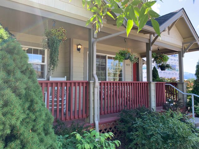 Great starter home on a corner lot.... Hellgate Elementary School District.  Raised garden bed, mature raspberry and blackberry bushes, an apple tree, rose bushes, and the main tree is a crab apple tree. We also have underground sprinklers and AC! For more details call Ryan Klemundt at 406-396-4270 or your real estate professional .