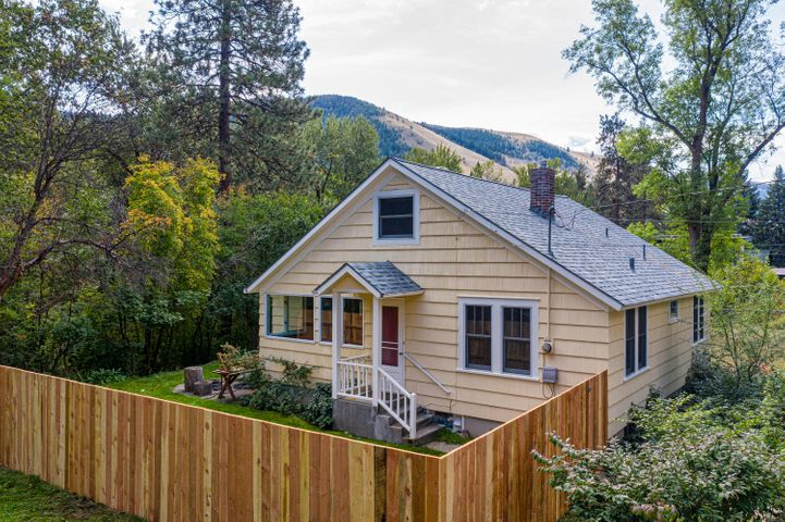 Situated privately on a quiet street in the heart of the beautiful Rattlesnake, you'll find this charming 1938 bungalow style cottage.  Fronting the pristine Rattlesnake Creek on an approximately 16,284 square foot lot, this house features 3 bedrooms, 2 bathrooms, hardwood floors, built-ins, full unfinished basement and newly installed privacy fence. There's so much to love about this property with its mature trees, creek frontage and prime location in a peaceful neighborhood near trails and convenient to the University of Montana and Downtown Missoula amenities.  Contact Danni Moore at 406-396-2442 or your real estate professional for a private showing.