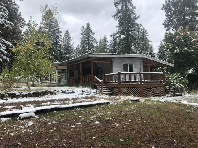 Build your own wilderness retreat on almost 10 level acres of property perched above the Missoula valley!  Enjoy being a part of nature while only being a short drive from town.  The property features an older manufactured home and a barn with a one bedroom apartment above, both being sold in AS-IS condition.  There is already a well, septic, and electricity so transforming it to your liking is easy!  The septic is approved for up to six bedrooms.