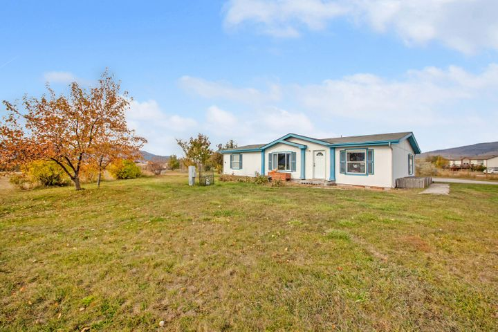 Affordable country living in the award winning Frenchtown School District.  Over 3 level acres, plus a veritable fruit orchard of cherry, plum, pear, apple and peach trees surround this lovely Guerdon home.  Interior was updated in 2016, with new flooring and paint, and stylish custom light fixtures in the open, spacious kitchen.  In addition, this home has end of the road privacy, a beautiful garden tub, spacious bedrooms, and a oversized double garage/shop with paved parking and driveway.