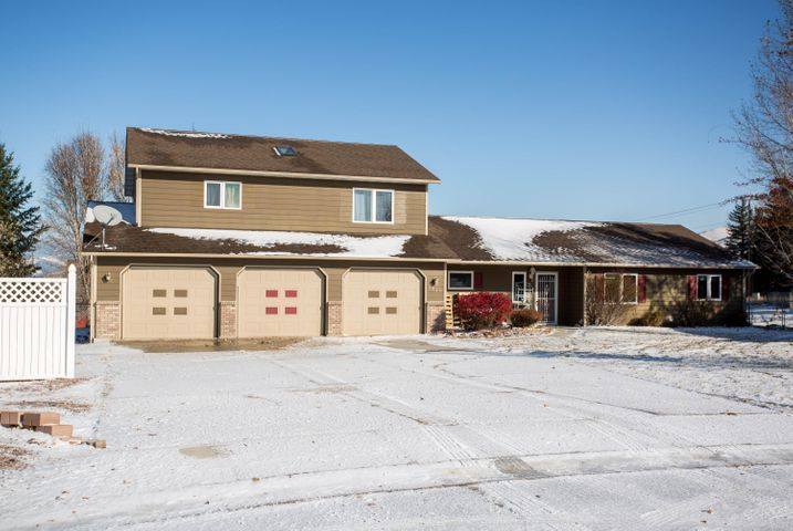 This Miller Creek home is one you don't want to miss. From the 3 car garage to the almost half acre lot, you'll want to make this your new home. 3 bedrooms 2.5 bathrooms with a bonus room in the main house that has had a full kitchen remodel with new appliances, cabinets and counter tops. 3 bedrooms 1.75 bathrooms in a spacious additional living area which is also partially ADA accessible. Walk out onto the covered back porch to enjoy a nice evening or head out to your expansive back yard w/ under ground sprinklers & large storage shed to store extra belongings. Contact Lucas Meriwether at 406.396.7913 or your real estate professional for more info