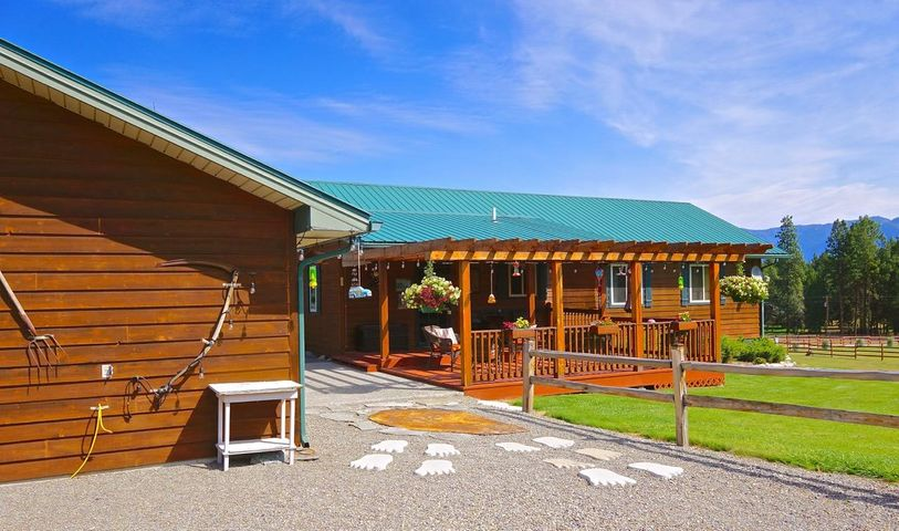 Lake Koocanusa is nearby this sweet 3 bedroom/2 bathroom home and garage! The property boasts beautiful mountain views and has 2 acres that can be kept green and beautiful with the gravity fed Young Creek Water that supplies the property. Comes with it's own well and septic system and a nice 2 car garage and workshop. Need more sleeping room for guests? No problem , the property has a bunkhouse in the back that easily handles the overflow !  The property is kept clean and immaculate and is ready for you to see ! CALL Gideon Yutzy at 406-261-1246 OR YOUR REAL ESTATE PROFESSIONAL