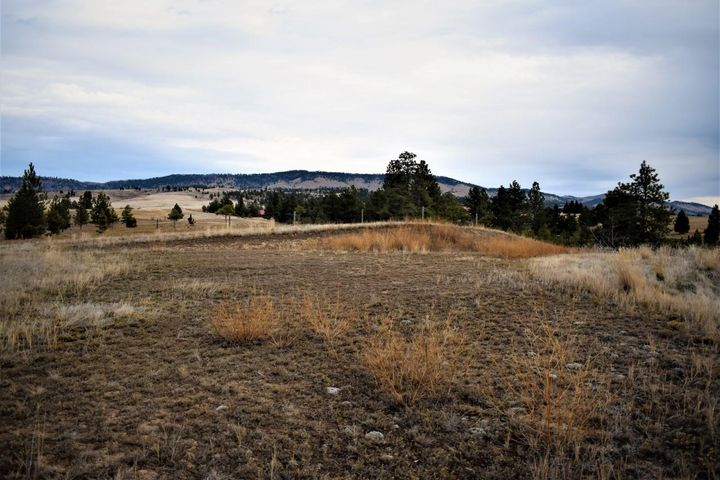 Affordable Spokane Bench acreage!  Beautiful setting that you must see to appreciate!  Road needs cut in and the property does not have a well or septic.  This is a one of a kind piece of property!  Rolling hills with a perfect spot for a single level home or one with a walk-out basement! Builders, take a peek!  Please be considerate of the neighbors and do not approach the property without an appointment. Call Tobie McDonnell at 406-202-3272 or your real estate professional!!