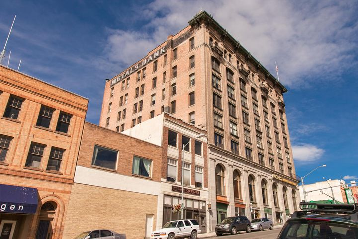 Historic Metals Bank Building corner of Park & Main, 4th floor condo, tasteful elegance in this remodeled condo.  Enter the historic rooms and feel the embrace of this great building. Condo has one bedroom, one bath, stainless appliances, granite counters, original woodwork, laundry area &  bathroom, many amenities within the building include indoor parking garage (at additional monthly charge), coffee shop, restaurant, second floor conference room available for your gatherings. Experience all that Uptown Butte has to offer, restaurants, theater, art walks, festivals & Christmas Stroll. More...