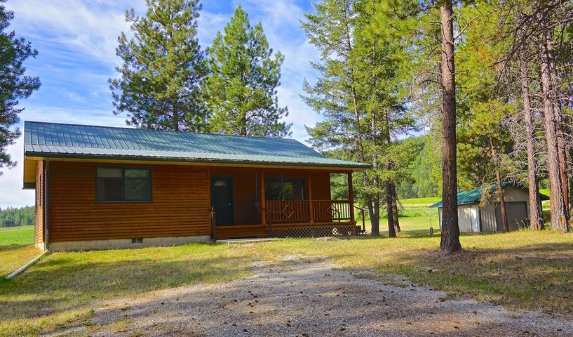 Home and Large workshop on 1-1/2 Acre Property.  Ranch style home has 2 bedrooms, 2 full baths, and dining room with a large window overlooking beautiful green hayfields and wooded hills. Also a spacious living room, vaulted ceilings and the large master bedrm and bath with a walk-in closet all on 1.5 beautiful W Kootenai Acres ! The property has a large 30x32  workshop heated w/75,000 BTU propane heater and comes with 110/220 voltage  w breaker box, 2 10 foot rollup doors, walk-in door, 8 ft fluorescent and a concrete floor ! A 2nd single car garage comes with a 7ft roll up door, walk-in door , a concrete floor and could easily be converted into a She shed or studio! Only blocks away from Lake Koocanusa and where you could launch your jet skis or enjoy great fishing and water sports!