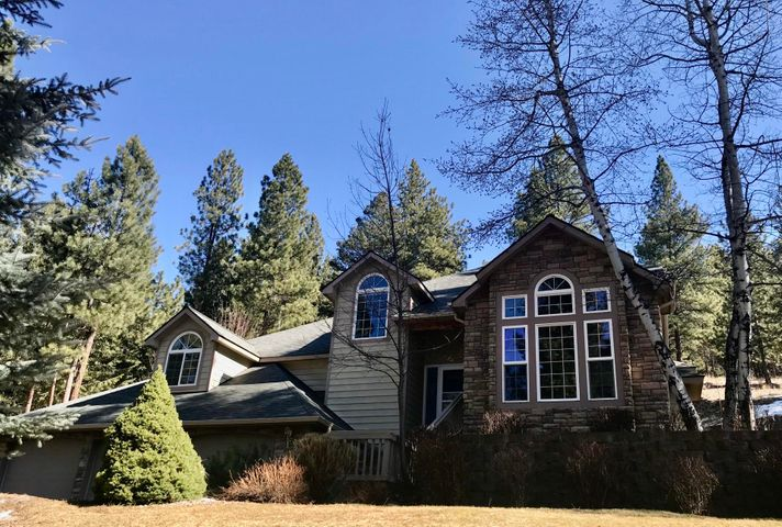 Outstanding custom home situated on 2.3 acres in the much sought-after Grant Creek area.  Live the Montana dream with a wonderful wooded forest, an abundance of wildlife and even an amazing treehouse (not just any treehouse!) just outside your back door.  This property is placed perfectly on the lot, so neighbors are not too close, and the back perimeter of the property is owned by the National Wildlife Federation. The meticulously maintained grounds offers a black walnut tree, (harvested 1200 last fall!!)  2 cherry trees, an apple, apricot, and a variety of maple, ash and elm trees. There is a fenced terraced garden area as well.  The well thought out floor plan of the home offers many features a home buyer is looking for in today's market.