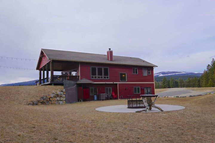 Walking distance to Lake Koocanusa ! This absolutely immaculate,modern, and practical 4 bedroom, 3 bathroom home has an idyllic setting with a most convenient location to Lake Koocanusa ! The property borders National Forest land on 2 sides with direct walking access to beautiful Lake Koocanusa ! Every single detail of this home and property is thought out very well and speaks of quality and comfort ! Large spacious covered decks, a garage bay large enough to store the boat over winter, A spacious open floor plan with the Kitchen, dining and living room put together in a most comfortable fashion excellent for entertaining or relaxing in NW Montana style ! Call Gideon Yutzy at 406-261-1246 or your real estate professional.