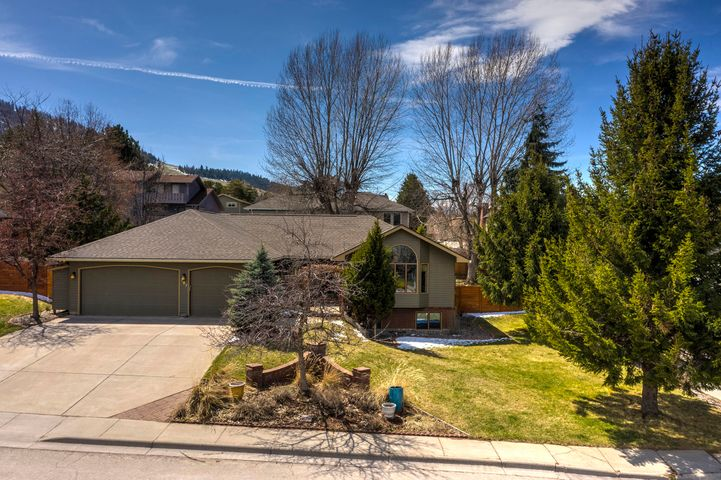 Location, Location: close to hiking, biking, golfing, restaurants, Pattee Creek Market, Pattee Creek Canyon and so much more! The location in this quiet neighborhood cannot be beat. 4 bedrooms, 3 bathrooms, 2 living-rooms and one large, fully fenced yard with a back deck for enjoying those upcoming Spring/Summer days. As you enter the home, you are greeted with a beautiful and lush front patio. This home provides a lot of light in each room and especially in the open kitchen! The main bedroom is located on the main level with a large closet and dual vanity. Two other bedrooms along with the mud room/laundry room are located on the main level. Downstairs you will find another bedroom, bonus room for storage, additional living room and bathroom. The triple car garage is hard to beat too!