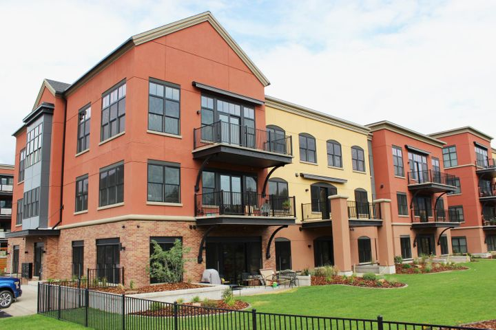 This ground floor 2-bedroom, 2-bath condo is located in Polleys Square D at Old Sawmill District. It has an open floor plan, 10-foot ceilings, large windows, a great patio overlooking the courtyard, enhanced sound protection between units (walls and floors), an individual storage unit, and a reserved parking space next to building. There is also an elevator and a gas line to the patio for your barbecue! This condo has been finished in the Premium Finish Option, with 42'' cabinets, granite countertops, engineered hardwood and tile floors with stained wood trim and a beautiful tile walk-in shower with frameless glass shower door. Appliance package includes gas range, microwave/hood, French-door refrigerator, dishwasher,
