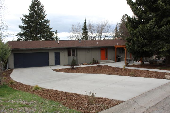 What a  great view of Lolo Peak and the Missoula valley from this Lincoln Hills home. Ranch style with daylight walkout basement.  You will love the open feeling of the kitchen and living room with vaulted ceilings, hardwood floors and tall gas fireplace. French doors from the master and living rooms to a big deck. Both bathrooms in the home have been updated and there is all new concrete in the driveway, sidewalk, patio  and garage. The family room has real oak paneling lots of built-ins and walks out to the back yard.  Lower level bonus room with nice wood paneling.  Ideally located to all of the hiking/biking trails on Mt Jumbo!