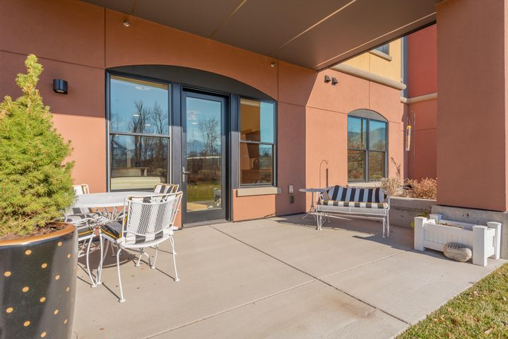 This lovely south facing ground floor condo offers a private patio in Missoula's coolest community close to downtown, trails, and all the great things Missoula has to offer.  Barely lived in this property is better than new with many upgrades, custom window coverings, and features the top of the line premium finish option with granite, over-sized cabinets, tiled shower, and an upgraded stainless steel appliance package.  The dedicated parking spot is just steps from your front door and there's also a large storage closet, gas plumbed to your patio and so much more.  With enhanced sound protection, 10 foot ceilings, over sized windows for natural light and an open floor plan this condo is perfect and ready to move right in to.  Come enjoy the Old Sawmill District and all it offers!