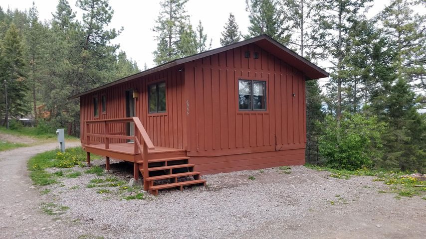 Open house 5/31 1-3. Live close to Lolo National Forest with its  walking trails, great views, and easy commute to Missoula.  This adorable cabin sits on 5 acres within 4 miles of Missoula.  Property has two buildings, electricity, and septic system and a shared will with the neighbor.  Red cabin can be used as a residence and the multi-story green building can be used for storage, artist studio, playhouse, whatever the multi-purpose zoning rules will allow. The cabin is located at the top of the property and affords privacy.  The lower end of the property is flat and could be used for pasture, storage area, open space, etc.This is your chance to be away from the bustle of town but close enough for the conveniences.  Call Jim at 239-1206 or your real estate professional.