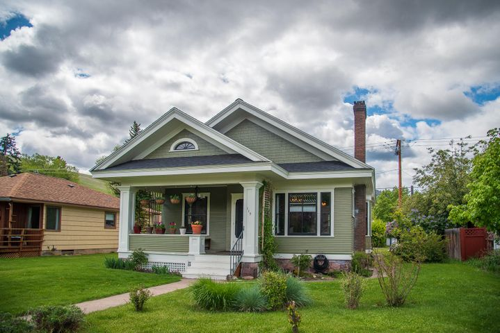 A 1906 Bungalow in the U district that will make your heart dance!  The ideal craftsman front porch ideal for enjoying Missoula mornings/evenings.  Inside take note of the preserved character in the decorative fireplace, built-in bookcases, leaded glass windows and carved wood craftsmanship.  The current owner beamed the kitchen to help open up the space and added modern appliances including a double oven and additional cabinetry. Tiled backsplash and beautifully painted cabinets add polish and style to this charming house. The full bath on the main floor has a generous soaker tub and tiling throughout. In the back of the house could be a 3rd bedroom which is currently the laundry room.  Hookups are still in the basement if you wanted to change it back to a bedroom.
