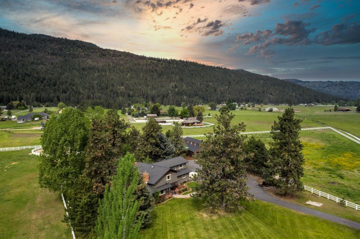 End of the road seclusion and privacy in one of Missoula's most sought-after neighborhoods! This incredible equestrian estate boasts a rare 10 acres in the Big Flat neighborhood with remodeled craftsman style home. The property is a fully operational horse estate with a beautiful barn equipped with Priefert panels, covered riding ring, full outdoor riding arena, automatic waters and a tack room. There is a three bed-room apartment in the barn with kitchen, full bath, and laundry. In the main home, the main living room soars with 17' ceilings and an irreplaceable custom stone fireplace from floor to ceiling.  Grand master suite and gourmet kitchen with Cherry cabinets and granite countertops. Hand-scraped Cherry wood floors. Covered and open air patio with hot tub. Gazebo. Field irrigation.