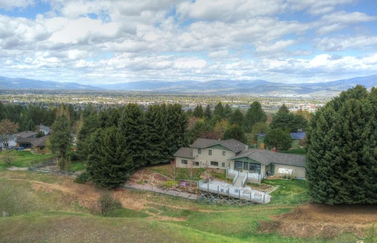 FABULOUS Montana views:  Stone Mountain, Lolo Peak, rolling ranch land, grazing herefords.  Beautiful Farviews home.  four bedrooms, 2 1/2 bath, plus family room and studio/workshop. Fully landscaped with extensive deck and greenhouse.  UG sprinklers.  3582 sq. ft.  Great place for a growing family or to simply enjoy the Montana lifestyle.