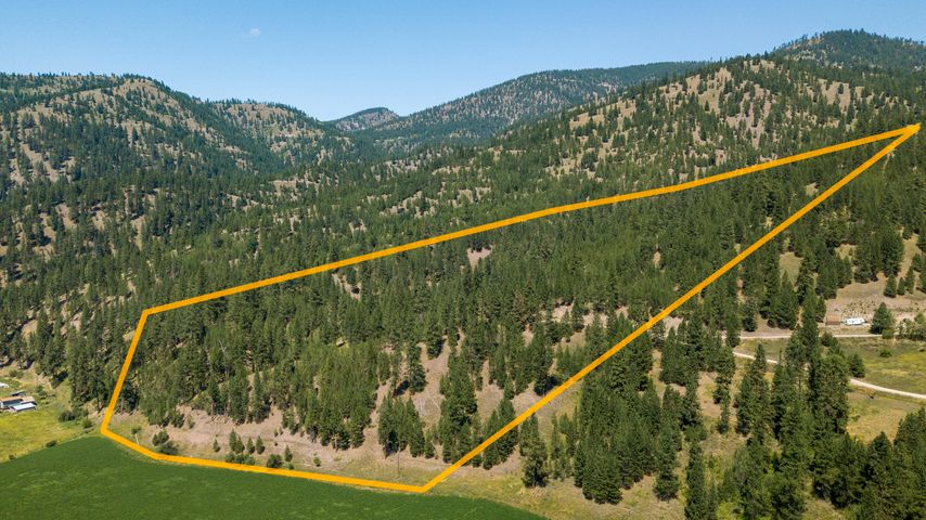 Bring your own builder! Beautiful 20-acre residential parcel 20 minutes from Missoula at Clinton. Gorgeous views, privacy and solitude, but still close to town. Next to Plum Creek drainage, there is power and phone to the property and it has year-round access so a great place to build your home and get out of the city. Ikes Peak Road is a private road shared with 2 other homes. Most of it is paved and there is only 1/4 mile of road to the lot that is unpaved. There is a year-round natural spring on the property. There is an abundance of trees and a cleared mostly level building area. Call Leslie Wetherbee at (406) 880-4537 or your real estate professional today to see this amazing property!