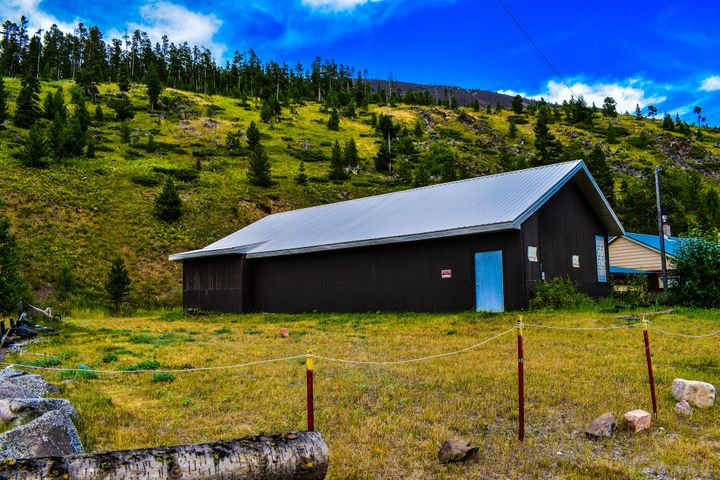 LOWER PRICE! with sound structure to create your own Neihart dream home. 21.5 Neihart city lots included. City water stubbed in and septic ready for hookup. Solid construction but needs your touch and finishes to create that  ski, hunt, snowmobile, hiking  base camp for you and your family or friends. Close to Showdown and Silvercrest with a restaurant and bar just down the street for after activity dinners and a cold one. BRING OFFERS!