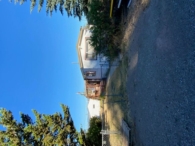 This lot has privacy with the trees and shrubs.  Views of the surrounding mountains from the covered deck!  Mobile home is in poor condition and property is being sold ''as is''