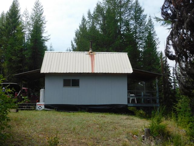 A True Hunters, snowmobilers, side by side and/or weekend get away for any outdoor enthusiast. Borders USFS and boasts incredible views along with miles of walking trails. You can take back roads on your quad, side by side or snowmobile and end up in Whitefish or Lake Koocanusa. This is a real nice cabin that has been well taken care of. Also has telephone and high speed internet. Take a look for your self!Contact Terry Comstock at 406-250-7722 or your Real Estate Professional.