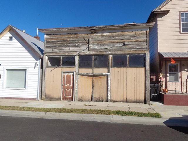 Uninhabitable building on residential lot with unknown potential.  Improvement described as frame shed dated to 1900.  Bring offers to Listing Agent.