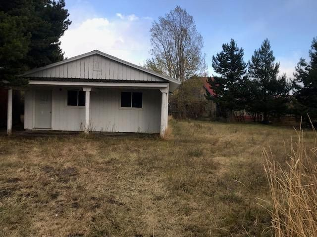 Spacious lots located on Marie Street. Plenty of potential with this property.  The main building (24x46) was a church but has one bedroom and two bathrooms.  Could be converted into a nice cabin.  There is an outbuilding that is 14' 2''x27'10' formerly used as a Fellowship Hall.  Main building has 5 year old forced air gas furnace.  Fellowship Hall has a gas heater and kitchen cabinets.  Lot is .402 acres with lovely mountain view.  Since this property has been in non-profit status since 2000, the taxes will need to be reassesses when taken out of that status.  Call Colleen Erickson 406-226-5555 or your real estate professional.