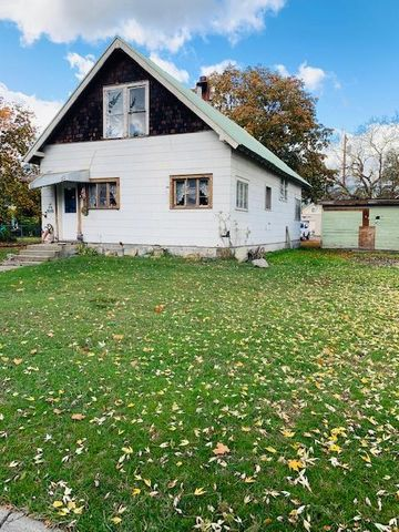 Back on Market at no fault of property!!  Cozy 2 BD, 2BA home with high ceilings and sitting on 3 city lots. It's ready for someone to make it their own with a little TLC. The wood stove is ready to keep you toasty warm this winter. Come summer the garden is ready to go with a area fenced off for fresh fruits and veggies to enjoy sitting in the shade of the trees. Call Cora Gilmore @ 406-291-3130 or your real estate professional.