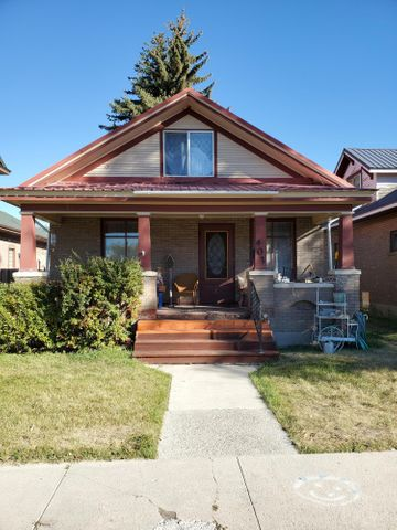 Charming Craftsman will make a great starter home.  1 bedroom on main floor, with finished rooms on second floor that could either be used as a bedroom, craft room, or both!  South facing front porch for your evening enjoyment!  Hardwood floors in living and dining area.  Laundry room in basement.  Metal roof.