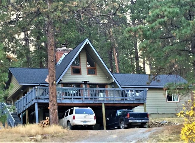 Adorably updated home in a desirable location located just minutes outside Helena. Nearly 2 gorgeous acres with boulders and pines throughout! This charming house has 3 bedrooms, 2 bathrooms and a single tuck under garage with plenty of room to bring your toys and a circular drive for convenience. Roof, wiring , plumbing and more have been updated! Entertain your guests around the fire pit or enjoy the gorgeous Montana views and wildlife from on of the 2 large decks! Home is ready for you to come relax, cozy in and enjoy the beautiful Montana scenery. COME HOME!
