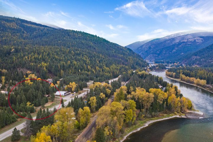 Spacious three bedroom, two bath home with large living room open to kitchen and dining. Warm by the fire and relish the views of the mountains and wildlife. Beautiful, level land with garden potential on nearly two acres of treed privacy across the highway from the Kootenai River. Next door to Zero uno Zero the Robot Art Gallery. Short drive to Kalispell, Whitefish, and Glacier National Park. Call Kara Chapman (406) 407-7509 or your Real Estate Professional.