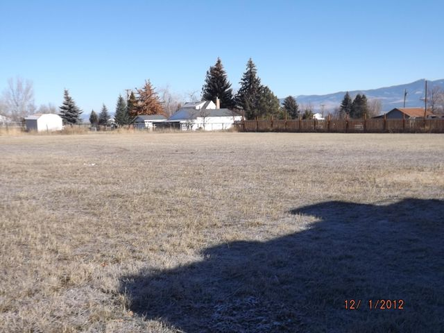 Pretty westside rural property. Ranch - style house in poor condition. 3 bedrooms, 1.5 baths. Double detached garage.